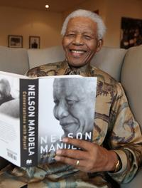 Nelson Mandela with his book <i>Conversations with Myself</i>