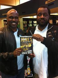 Marvin poses for a pic with Solomon Jones and one of his best-selling books.
