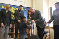 Mayor Kenney gives kindergartners their first Free Library cards at Southwark Elementary in 2017. (Photo by Samantha Madera.)