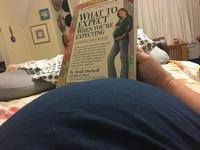 The author with a copy of What to Expect When You're Expecting