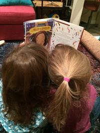 The author's daughters reading Grace for President