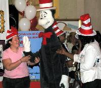 The Cat in the Hat is ushered onstage by members of his entourage.