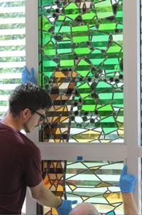Cooper O'Neil's original stained-glass window installations, Explore and This Place, draw upon architectural elements from the immediate Mt. Airy community.