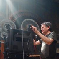 Jay Schwartz works the projectors at a screening at Fleisher Art Memorial. (Photo by Silvia Hortelano-Pelaez.)