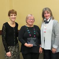 Peg Szczurek accepting award from Denise Agosto of Drexel University and Siobhan Reardon, President and Director of the Free Library of Philadelphia