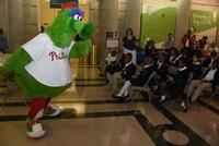 The Phillie Phanatic gets students pumped up for Summer Reading during Summer Reading Kickoff at Parkway Central Library