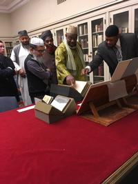 Five imams visiting the Rare Books Department