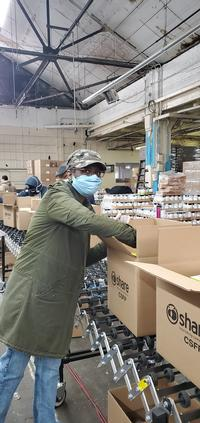 Sheryl at the SHARE Distribution Center