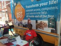 Ken Manns, Director, Volunteer Services Program, with the Techmobile outside South Philadelphia Library's grand opening block party.