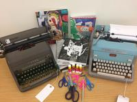 Typewriters provided by Philly Typewriter and art catalogs by Philadelphia Museum of Art Library