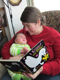 Eastwick Branch Librarian Tara reads to her baby!