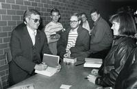 Tom Clancy signs books for fans