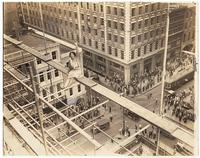 Vivian Shirley sitting on scaffolding atop the Federal Reserve Bank (under construction), 6/14/1930