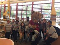 Daniel Tiger joins Words at Play staff and volunteers to celebrate a successful Block Party.