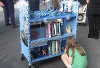 A young attendee inspects reading options offered by the Fumo Family Branch's ocean-blinged booktruck.