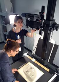 Brittney and Meg digitizing the Charles Henry Sykes political cartoons in our Collection Care department.