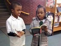 Students check out their own library books during their school-day Building Bridges visit to Joseph E. Coleman Library.