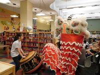 Holy Redeemer School students performing the traditional Lion Dance with drummers at Independence Library.