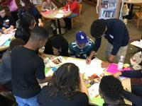 Teens drawing their vision.
