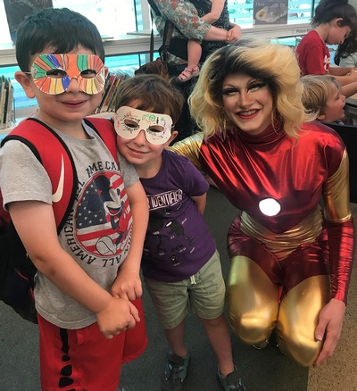 These children and superheroes are enjoying a recent Drag Queen Storytime!