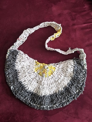 My first plarn project was Stitch and Hound's Half-Moon Tote using the equivalent of about 70 plastic shopping bags. Pattern: https://stitchandhound.com/plarn-half-moon-tote/