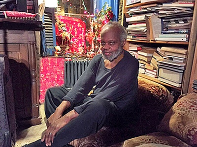 A portrait of Grimes at home in 2015, posted in the announcement of his passing by his widow, Margaret Davis-Grimes, whose writings at henrygrimes.com made this blog post possible. Photo by Aksel Theilkuhl.