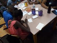 Group of kids participating in Mighty Writers workshop at Great Olney Library