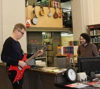 Music Department Librarian Perry Genovesi enjoying a personal concert from Nels Cline, as he plays one of the circulating guitars & amps from our Musical Instrument Collection.