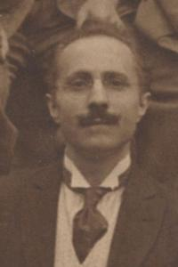 Arturo Andreoni (1876-1970). Detail from Choral Classes 1917-1918 group photograph. https://libwww.freelibrary.org/digital/item/10574