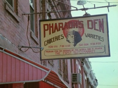 The sign outside the Pharaoh's Den, the grocery store that Arkestra members operated in Germantown in the1970s.