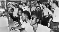 The four men at this 1960s Mississipi lunch counter will be arrested.