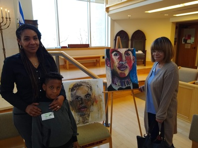 Trina Singleton and Son with portraits.