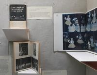 Installation detail showing two editions of <i>Sweet Wallpaper of Life</i> by Roy de Carava and a photographic collage by Clarissa Sligh