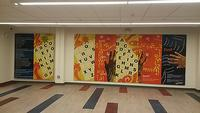 Visitors to the recently-renovated Logan Library can also find Trapeta's verse beautifully painted on the wall of the Community Room as part of a mural by Ife Nii Owoo.